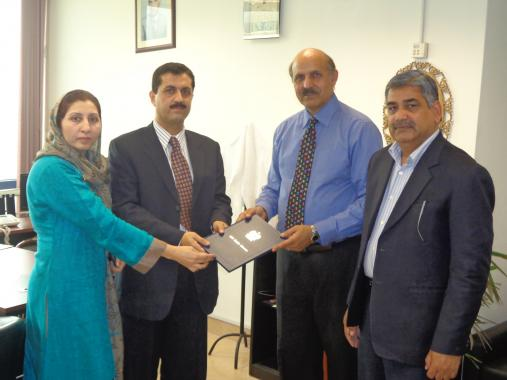 D.G Licensing PEMRA, Mr. Jumani Ashfak presenting Radio Meezan FM 96.6 license to Sr. Director R&P/ Station Director Muhammad Aamir Nazir & Director Human Rights, PHC Mrs. Rifat Nazir on Monday March 11, 2013